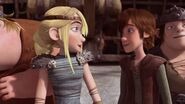Hiccup and Astrid happy at the news given to them by Gobber