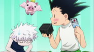 Gon trying to use his Hunter license to open the box