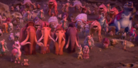 The herd and the Geotopians looking at the asteroid.png