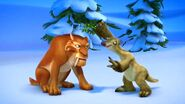 Ice-Age-A-Mammoth-Christmas-Sid-Holds-Mistletoe-Over-Diego