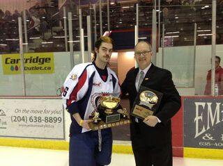 Jesse Sinatynski receives Mike Ridley Trophy