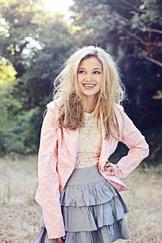 Olivia Holt Pink Jacket and Smiling