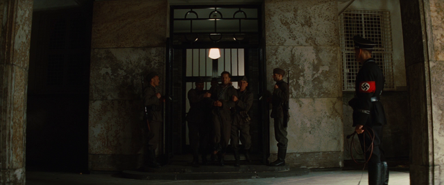 File:Hugo Stiglitz being escorted to the prison.png