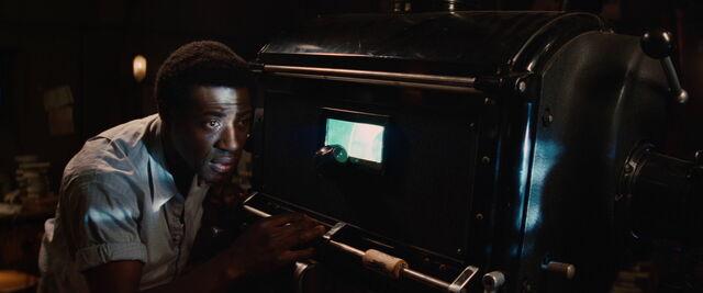 File:Marcel looks at the film.jpg