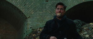 Aldo Raine with a sandwich in his mouth
