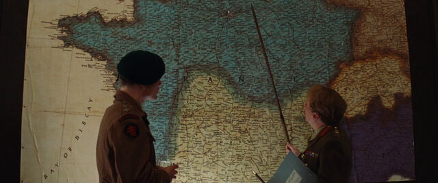 File:Ed Fenech points at the map.jpg
