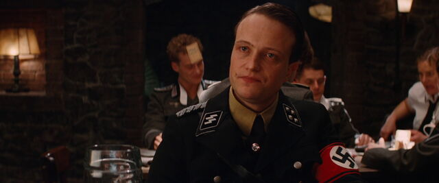 File:Dieter Hellstrom looks directly at Archie Hicox.jpg