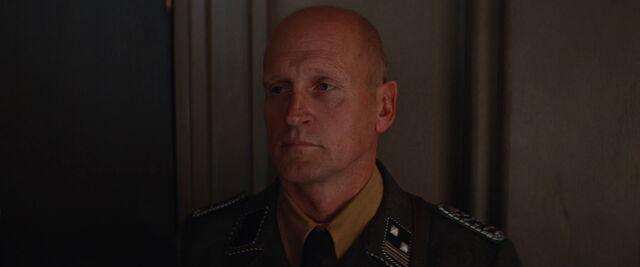 File:Bald German security guard.jpg