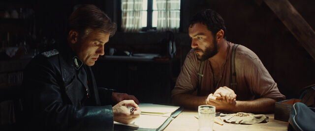 File:Hans Landa and LaPadite look in the notebook.jpg