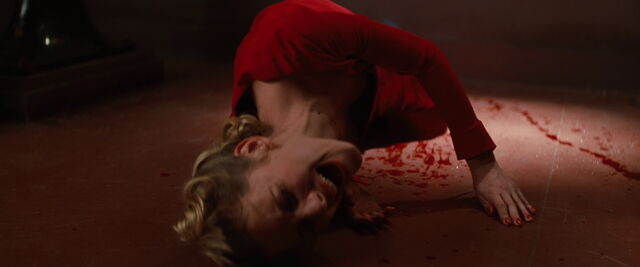 File:Shosanna rolls on the floor.jpg