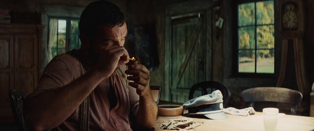 File:Perrier LaPadite lits his pipe.jpg