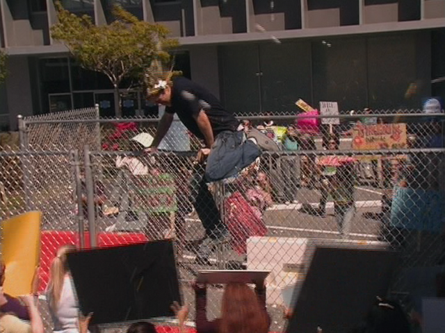 File:1x2 Dennis climbs fence.png