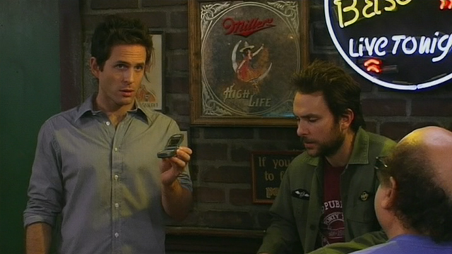 File:5x10 Dennis hold phone.png