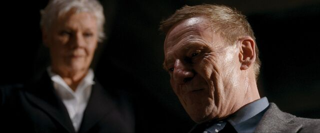 File:Quantum of Solace - M personally oversees the interrogation of Mr White.jpg