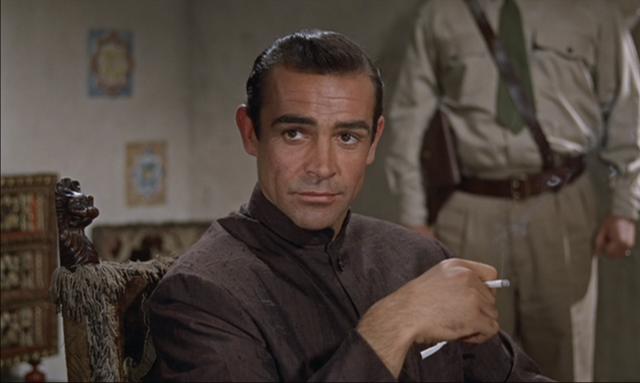 File:Dr No - Bond at dinner.png