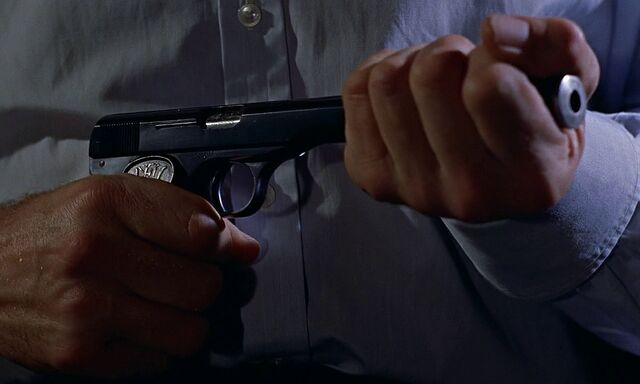 File:Bond puts suppressor onto Model 1910.jpg