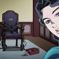 Yukako proudly showing Koichi her homemade electric chair.