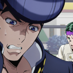 Rohan tries to get Josuke's attention on the bus.