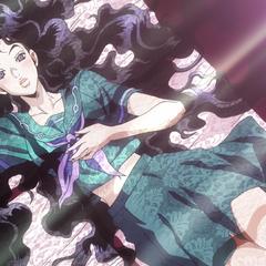 Yukako lying seductively on a bed.