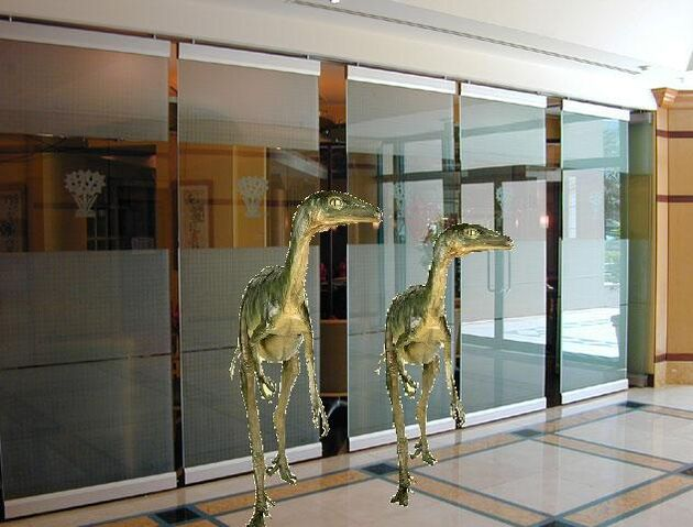 File:Troodons in office.jpg