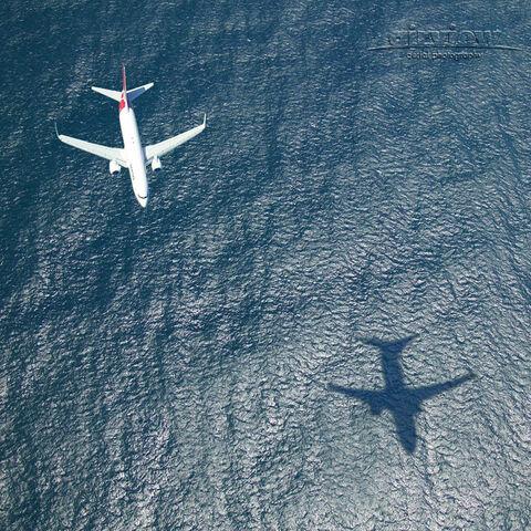 File:Plane over sea.jpg