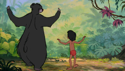 Mowgli and Baloo the bear are both danceing