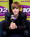 Justin Bieber promotes My World 2.0 at the Q102 radio station