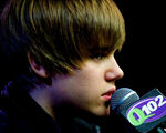 Justin promoting his CD 'My World 2.0' at the Q102 radio station
