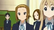 Michiko and Keiko behind of Ritsu