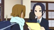 Natsuka giving Ritsu Sawako's card