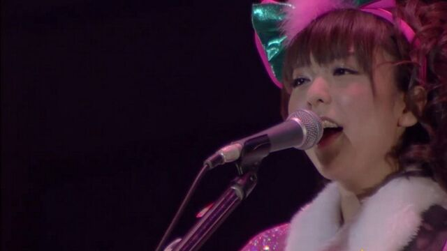 File:Aki singing as Yui (Live Concert Let's Go!).jpg
