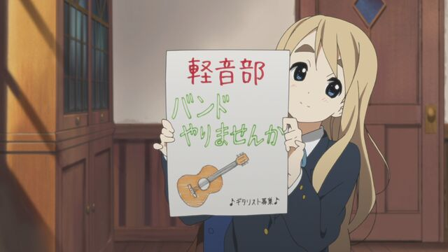 File:Mugi with poster.jpg