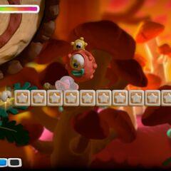 Sportle atacando a Kirby.