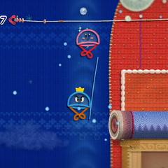 Kirby y el Príncipe Hilván transformados en paracaídas.