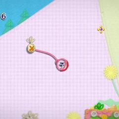 Kirby usando su látigo de hilo para columpiarse en forma de péndulo.