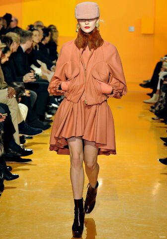 File:Kenzo Fall Winter 2012 peach round neck dress with fitted bodice and pleated flared skirt with asymmetrical hemline.jpg