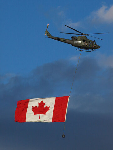 File:Canadian Military Helicopter with Canadian Flag.jpg