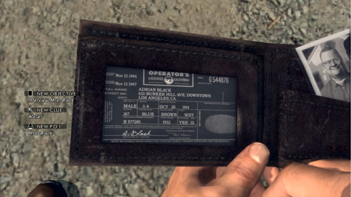 Plik:Adrian Black's wallet.jpg