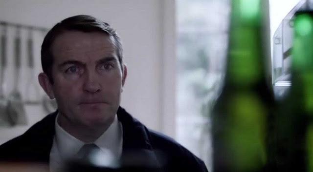 File:Ronnie's eyes on the bottles in Matt's fridge in Survivor's Guilt.jpg