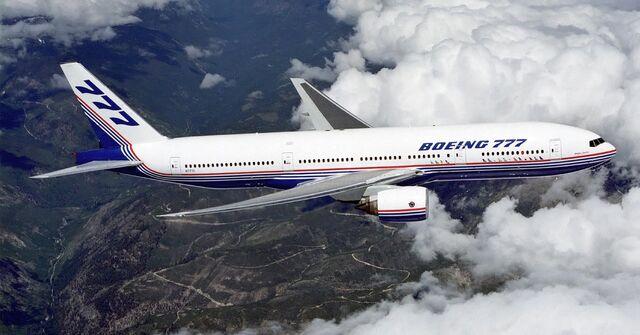 File:Boeing 777 above clouds, crop.jpg