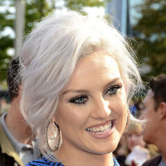 Perrie's wavy silver bouffant, side part updo hairstyle