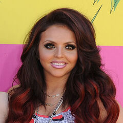 Jesy's wavy medium brown, red dip dyed, side part hairstyle