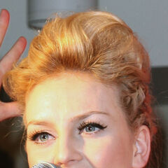 Perrie's golden brown hairs in cornrows, pampador updo.