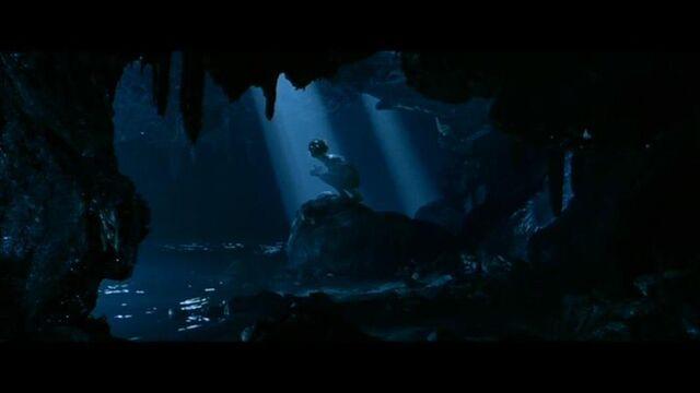 File:Gollum in his cave.jpg