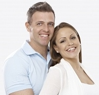 File:19354578-young-couple-expecting-a-baby-hugging-smiling-happy.jpg