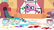 Minka throws paint with tail