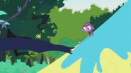 Purple Monkey runs up tree