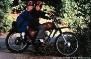 Madeline and Pepito on a motorbike