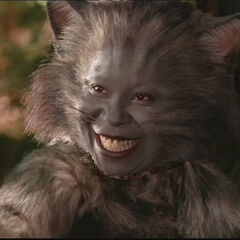 Whoopi Goldberg as Cheshire Cat