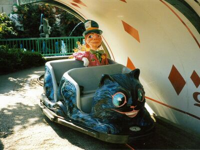 Photo Mad Hatter Alice in Wonderland Ride 06 Cheshire Cat Carriage Ride Playing Card Arch